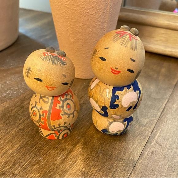 Vintage wood Japanese kokeshi dolls.